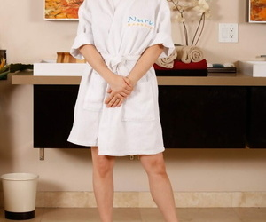 Masseuse with crimson hair Penny Pax peels off before her..