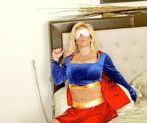 Blindfolded blonde Jennifer Adams fucks in a superhero..