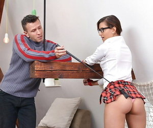 Glasses clothed schoolgirl taking naked butt lashing..