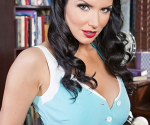 Dark-haired headmistress Romi Rain with inked back taunts..