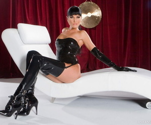 Super sexy whore in high ltex shoes and gimp outfit takes..
