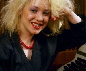 Ash-blonde secretary Ann R sports a creampie after fucking..