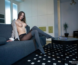 Long legged black-haired solo lady Mary W stroking with..