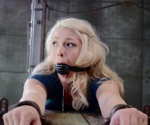 Blond schoolgirl Ella Nova is rendered helpless in a dungeon