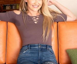 Blonde amateur Adira Allure slides denim over her bodysuit..
