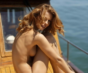 Redhead model Valeria Lakhina terrific binoculars while..