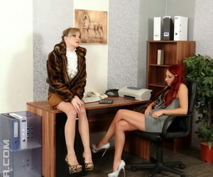 Totally clad secretaries have a threesome with their..