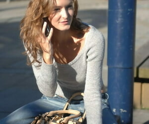 Solo girl Nikkala Stott takes off her sweater after having..