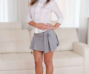 Stunner Nataly is pissing in her tight miniskirt and..