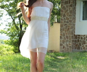 Beautiful teen Valery Leche steps out of her sundress to..