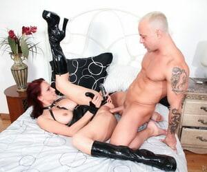 Female dom mistress Nicki Hunter dons belt cock to..