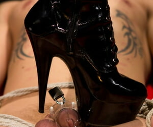 Ash-blonde domme Lorelei Lee submits a masculine sub to a..