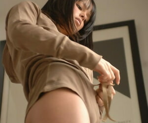 Scorching black-haired Sasha B stands naked in front of a..