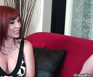Redhead milf in stockings gets..
