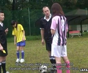 Asian soccer player gets a yellow..