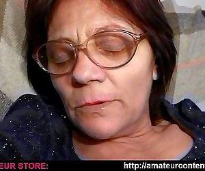 Granny Lisa dildoing in armchair..