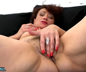 Hairy mature pleasures herself on..