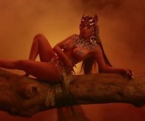 Nicki Minaj dances..