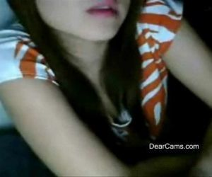 Fair cute Asian webcam stripping..