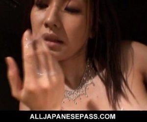 Japanese MILF titty-fucks for a..