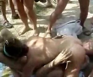 Hot lesbians having fun with strangers at nude beach. - 2 min