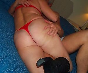 Horny mature woman in black boots..