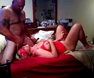 beefy guy dominates woman in mask