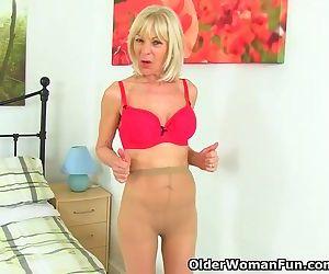 British gilf Elaine toys around with her dildo