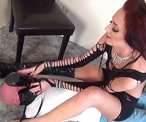 Tall girl dominates tiny slave