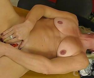 A Sexy Cougar Masturbates