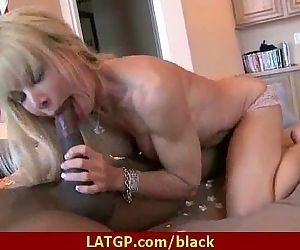Hot MILF deepthroats gags and gets banged by a black cock 13