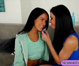 India Summer and Megan Rain making out on the couch