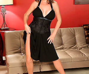 Karen deville is wearing a sexy black dress that shows her..