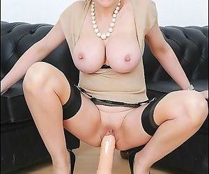 Big tits mature lady sonia is sitting on her big sex dildo..