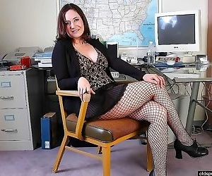 Busty mature plumper in fishnet playing dildo in office -..