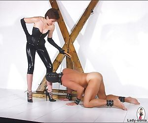 Rubber clad mistress lady sonia punishing her slave - part..