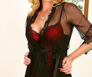 Elegant blonde cougar posing in lingerie - part 2648