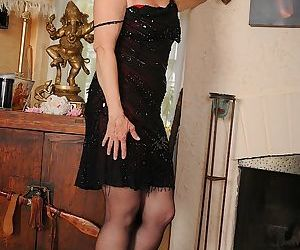 Older blonde lady Annabelle Brady posing in high heels and..