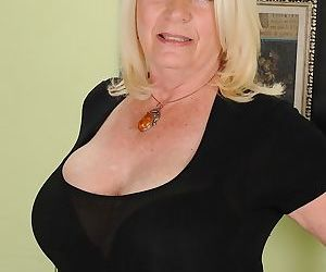 Fatty mature blondie Angelique is revealing her big boobies