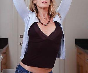Stunning blonde mature Simone Sonay showing off her..