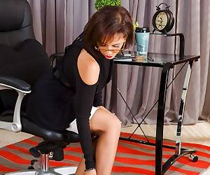 Mature secretary Roni Ford showing her big ass in sexy..