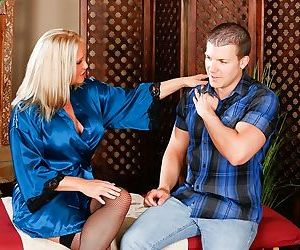 Mature blonde masseuse Maya Devine takes care of her..