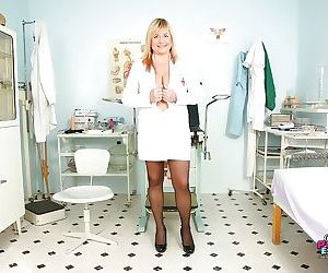 Fatty mature nurse unbuttones her uniform and exposes her..