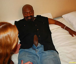 Mature redhead Dee Delmar gets slammed hard by a black cock