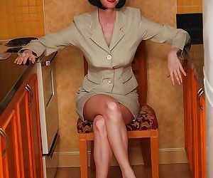 Foxy mature lady on high heels stripping off her suit and..