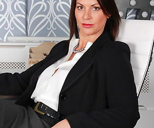 Fully clothed business woman flashes her bra and bare ass..