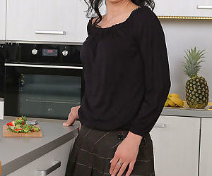 Mature wife Pamela Price lunches on the table naked..