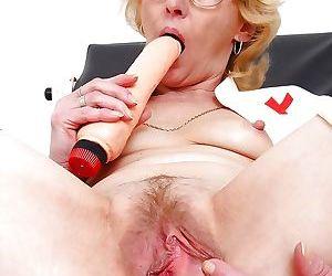 Sensuous mature nurse in glasses masturbating her cunt..