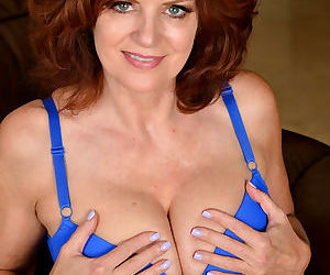 Mature wife Andi James strips blue lace panties to spread..