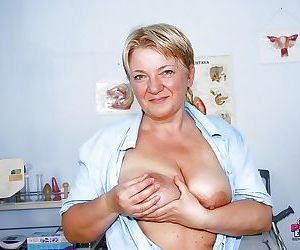 Fatty mature lady pumping her flabby tits and toying her..